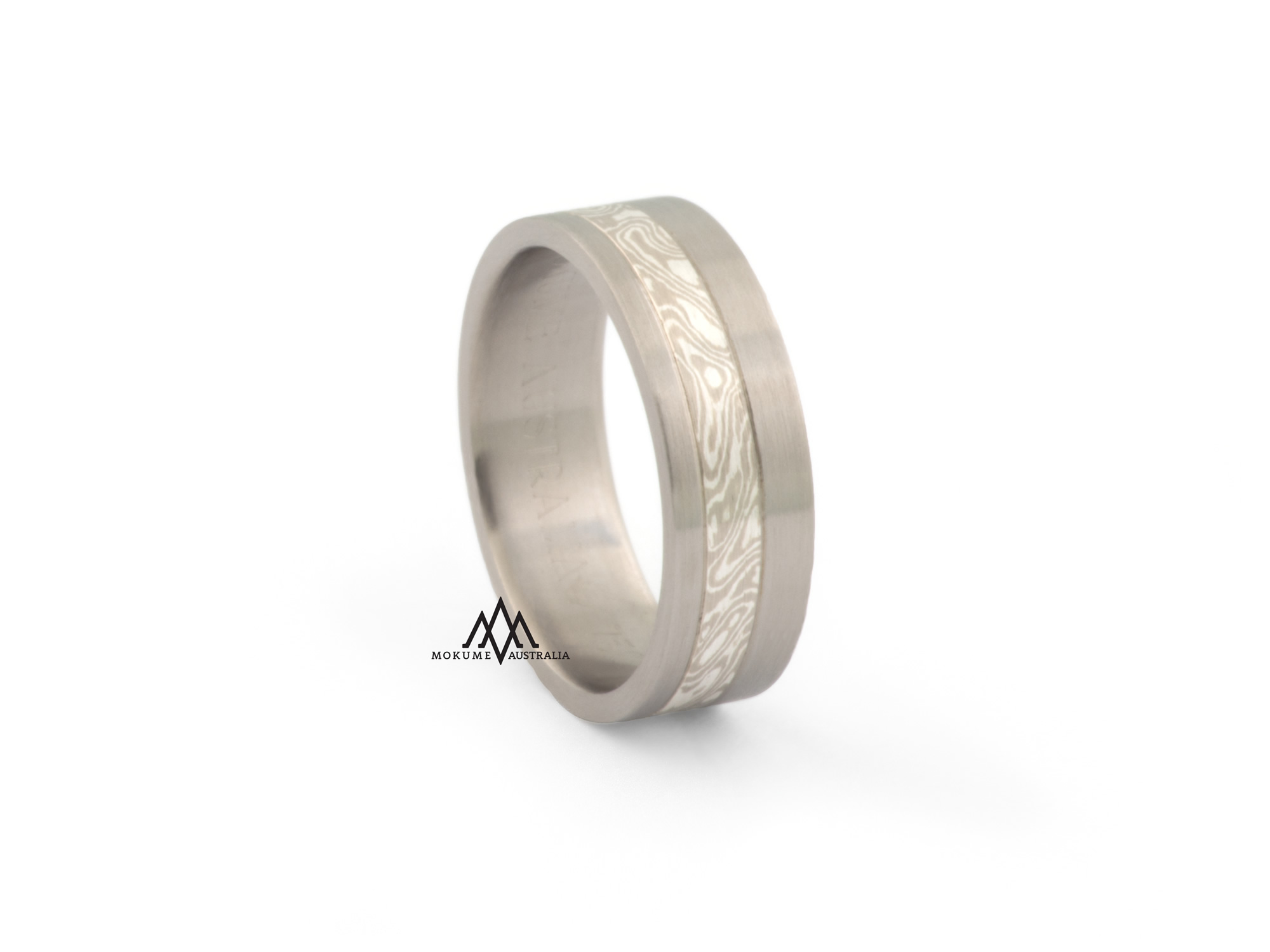 Grey/white off-centre flat mokume-gane ring