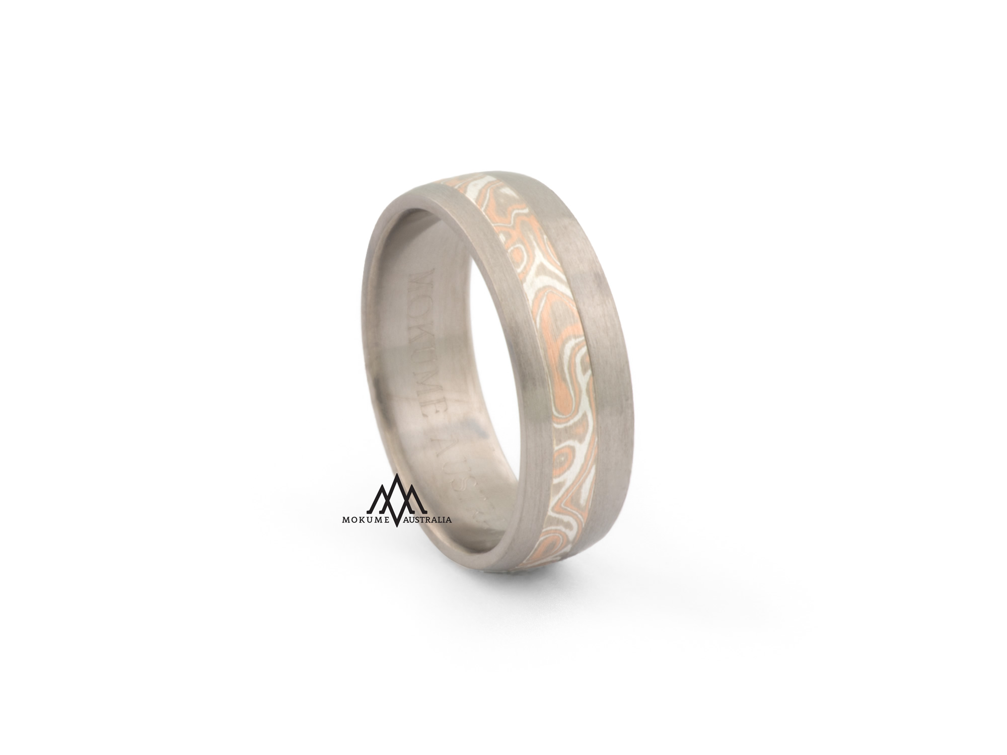Grey/white/rose off-centre round mokume-gane ring